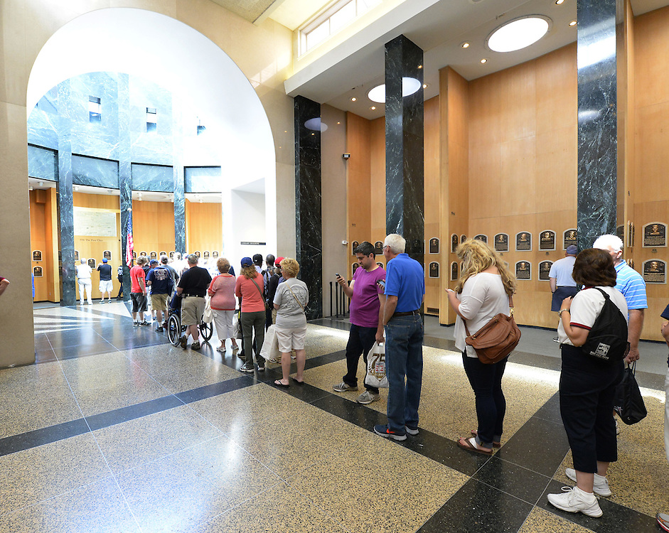 COOPERSTOWN, NY - JULY 28:  A general view of fans lined up to view the freshly installed HOF plaques featuring the 2014 Hall of Fame inductees on display at the Baseball Hall of Fame and Museum in Cooperstown, New York on July 28 2014.