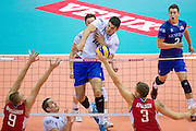 (C) Nicolas Le Goff from France attacks against (L) Alexey Spiridonov and (R) Nikolay Apalikov both from Russia  during the 2013 CEV VELUX Volleyball European Championship match between Russia v France at Ergo Arena in Gdansk on September 25, 2013.<br /> <br /> Poland, Gdansk, September 25, 2013<br /> <br /> Picture also available in RAW (NEF) or TIFF format on special request.<br /> <br /> For editorial use only. Any commercial or promotional use requires permission.<br /> <br /> Mandatory credit:<br /> Photo by &copy; Adam Nurkiewicz / Mediasport