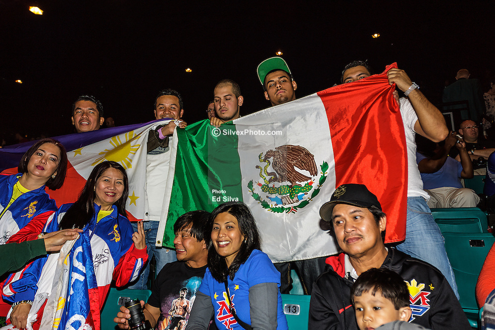 """LAS VEGAS, NV - DEC 7: The crowd was a mix of Mexican, Mexican-American, Filipino and Filipino-American fans at the Pacquiao vs Marquez 4 Weigh in at the MGM Grand Garden Arena in Las Vegas, NS. Some fans held banners that went as far as saying, """"Manny Pacquiao For President,"""" while others had over sized sombreros with the Mexican flag colors. Fans of Pacquiao chanted, """"Manny! Manny! Manny!"""" Fans of Marquez fired back with a song that basically goes like,  """"whoa whoa whoa Marquez! Marquez!"""". Byline and/or web usage link must  read PHOTO: © Eduardo E. Silva/SILVEX.PHOTOSHELTER.COM."""