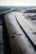 Nederland, Utrecht, Leidsche Rijn, 31-01-2010; het dak van de nieuwe landtunnel voor de A2. De tunnel ligt parallel aan de bestaande A2, het asfalt zal op termijn verdwijnen en op het dak van de tunnel zal een park komen. Links het Amsterdam-Rijnkanaal..The roof of the new landtunnel for A2. The tunnel lies parallel to the existing A2, the asphalt will eventually disappear and the roof of the tunnel will become park. Left the Amsterdam-Rhine canal..Left the Amsterdam-Rhine Canal.luchtfoto (toeslag), aerial photo (additional fee required).foto/photo Siebe Swart