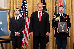 March 27, 2019 - Washington, District of Columbia, U.S. - President DONALD TRUMP presents the Medal of Honor to U.S. Army Staff Sgt. TRAVIS W. ATKINS (left) Wednesday, March 27, 2019, in the East Room of the White House. (Credit Image: ? White House via ZUMA Wire/ZUMAPRESS.com)