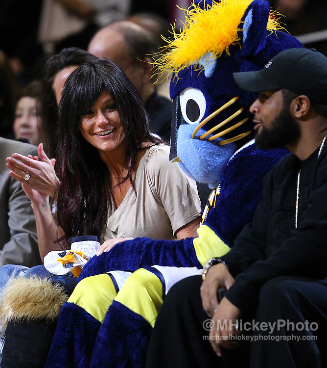 March 18, 2011; Indianapolis, IN, USA; Jenni JWoww Farley reacts as Indiana Pacers mascot sits down beside her courtside at Conseco Fieldhouse. Indiana defeated Chicago 115-108. Mandatory credit: Michael Hickey-US PRESSWIRE
