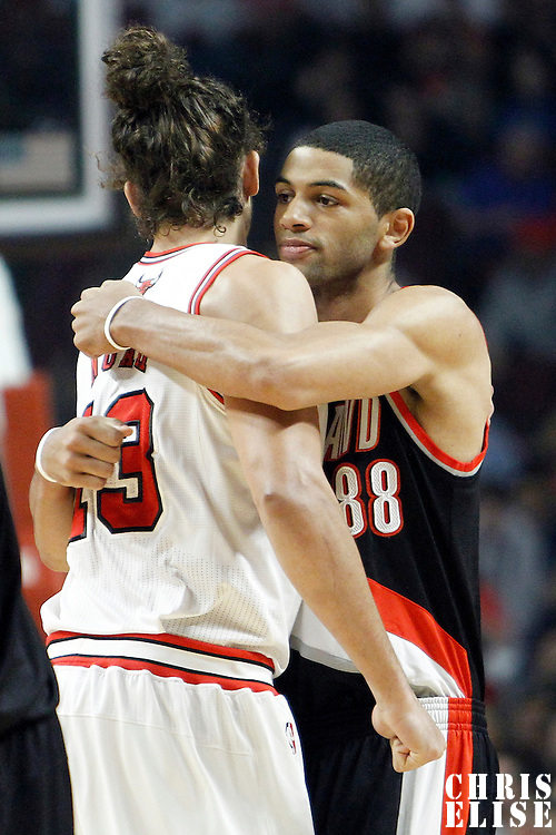 16 March 2012: Portland Trail Blazers small forward Nicolas Batum (88) hugs Chicago Bulls center Joakim Noah (13) during the Portland Trail Blazers 100-89 victory over the Chicago Bulls at the United Center, Chicago, Illinois, USA.