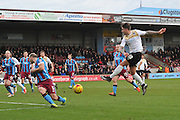 George Moncur of colchester United shoots at goal blocked by David Mirfin of Scunthorpe United during the Sky Bet League 1 match between Scunthorpe United and Colchester United at Glanford Park, Scunthorpe, England on 23 January 2016. Photo by Ian Lyall.