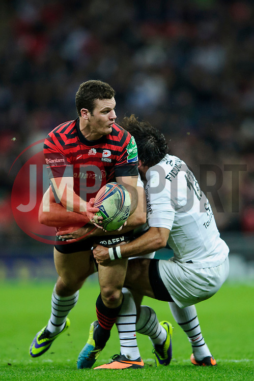 Saracens Inside Centre (#12) Duncan Taylor is tackled by Toulouse Inside Centre (#12) Clement Poitrenaud during the first half of the match - Photo mandatory by-line: Rogan Thomson/JMP - Tel: 07966 386802 - 18/10/2013 - SPORT - RUGBY UNION - Wembley Stadium, London - Saracens v Toulouse - Heineken Cup Round 2.