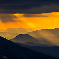 Sunlight rays over the mountain