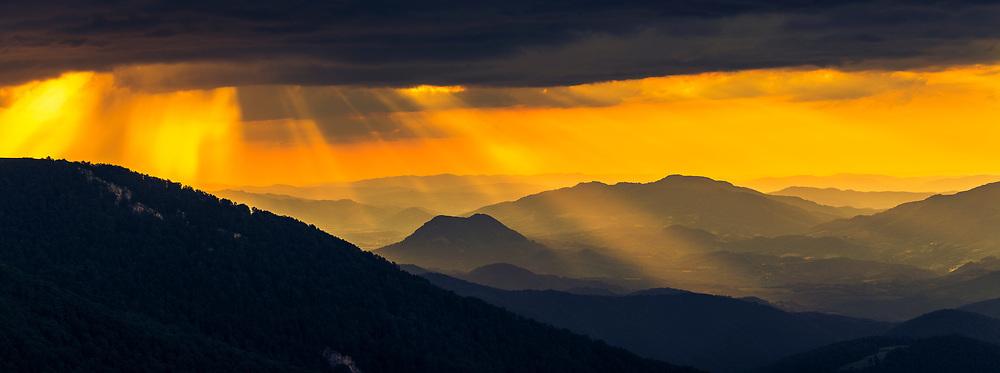 Sunlight rays over the mountain
