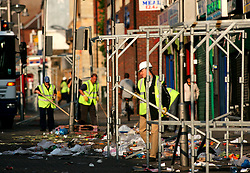 UK ENGLAND LONDON 15AUG06 - Clearing of  rubbish and stalls at the market in Walthamstow, north London, where Police are investigating an alleged bomb plot...jre/Photo by Jiri Rezac..© Jiri Rezac 2006..Contact: +44 (0) 7050 110 417.Mobile:  +44 (0) 7801 337 683.Office:  +44 (0) 20 8968 9635..Email:   jiri@jirirezac.com.Web:    www.jirirezac.com..© All images Jiri Rezac 2006 - All rights reserved.