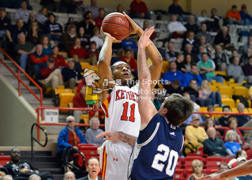 NCAA Men's Basketball: Stan Okoye launches a jump shot over Longwood's Karl Ziegler in his final game at Cameron Hall.  Okoye's 34 points and 16 rebounds led the Keydets to a 94-80 win over the Lancers on Saturday.