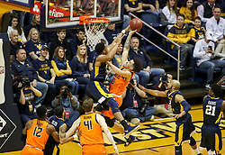 Feb 10, 2018; Morgantown, WV, USA; West Virginia Mountaineers forward Sagaba Konate (50) contests a shot against Oklahoma State Cowboys guard Jeffrey Carroll (30) during the first half at WVU Coliseum. Mandatory Credit: Ben Queen-USA TODAY Sports