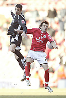 Photo: Aidan Ellis.<br /> Barnsley v Swansea City. Coca Cola League 1. 04/03/2006.<br /> Swansea's tommy Williams out jumps Barnsley's Martin devaney