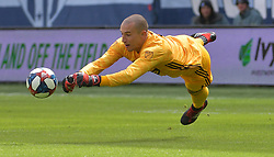 Mar 30, 2019; Kansas City, KS, USA;Montreal Impact goalkeeper Evan Bush (1) dives to stop a shot on goal during the first half against Sporting Kansas City at Children's Mercy Park. Mandatory Credit: Denny Medley-USA TODAY Sports