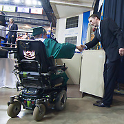 060211 Newark DE: Bob Carpenter Center Technical Coordinator George Watson (Left) shaking hands with a St. Georges Tech student after  Watson assisted a student get on a portable elevator during presentation of Diplomas at St. Georges Tech HS graduation Thursday, June 2, 2011, at The Bob Carpenter Center in Newark Delaware.<br /> <br /> Special to The News Journal/SAQUAN STIMPSON
