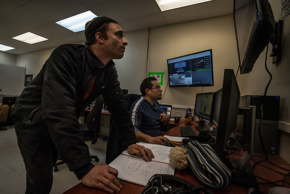 PICO DE ORIZABA NATIONAL PARK, PUEBLA, MEXICO - MARCH 27, 2015: Astronomer Sheperd Doeleman of MIT (left) and Scientist David Sánchez-Argüelles (right) monitor data being received inside the control room of the Large Millimeter Telescope after successfully connecting the LMT to several other telescopes around the world to make one large telescope called the Event Horizon Telescope, as large as the earth that the LMT team believes has the capacity to make the first image of the black hole.   CREDIT: Meridith Kohut for The New York Times