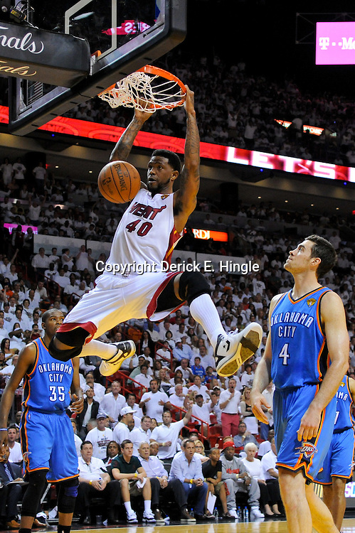 Jun 17, 2012; Miam, FL, USA; Miami Heat power forward Udonis Haslem (40) dunks against the Oklahoma City Thunder during the fourth quarter in game three in the 2012 NBA Finals at the American Airlines Arena. Mandatory Credit: Derick E. Hingle-US PRESSWIRE