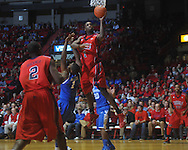 """Ole Miss forward Terrance Henry (1) shoots over Kentucky's Darius Miller (1) at the C.M. """"Tad"""" Smith Coliseum in Oxford, Miss. on Tuesday, February 1, 2011. Ole Miss won 71-69."""