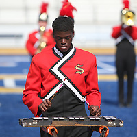 Dontravius McComb plays the bells for Shannon High School during Saturday's marching band competition at Tupelo High School