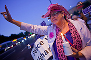 Dec. 2, 2009 -- PHOENIX, AZ: LISA BLANK, from Phoenix, a member of the antiwar group Code Pink, flashes a peace sign on a street corner in Phoenix Wednesday.  About 50 people from across the Phoenix metropolitan area attended the protest and vigil against the troop increase President Barack Obama announced on Dec. 1. Photo by Jack Kurtz