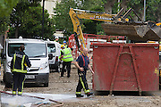 Firemen help in the aftermath following a burst water main which closed the otherwise busy junction of Half Moon Lane and Dulwich Road in the south London area of Herne Hill. Emergency services were called at about 5am, when water inundated local businesses, forcing shopkeepers and owners to evacuate their properties and leave before electricity supplies were shut down. Copyright Richard Baker / Alamy Live News.