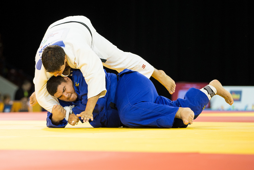 Jose Cuevas (Top) of Mexico tries to avoid being thrown by Pedro Pineda of Venezuela during their bronze medal contest in the mens judo +100kg class at the 2015 Pan American Games in Toronto, Canada, July 14,  2015.  AFP PHOTO/GEOFF ROBINS