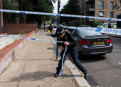 © Licensed to London News Pictures. 12/07/2020. London, UK. Police at the scene of a murder on the Black Prince Estate in Kennington South London, just a few hundred years from the House of Parliament,  in which a man, believed to be in his 30s, was stabbed to death late last night . Photo credit: Ben Cawthra/LNP