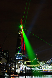 © Licensed to London News Pictures. 05/07/2012. London, UK. Laser and light show on 5 July 2012 marking the official inauguration and exterior completion of the London Shard. 12 lasers and 30 searchlights beamed from the skyscraper and illuminated the capital, joining the London Shard with 15 of London's key landmarks. The London Shard was designed by architect Renzo Piano and is Europe's tallest building standing 310m (1,016 ft) and 95-stories high. Photo credit : Vickie Flores/LNP