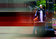 Jack Wolfinger waits at a light on the street in downtown Portland as the MAX moves on past. A promising basketball player, he let distractions take him away from the game. he's now working hard to get back his game.