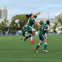3rd year forward Brianna Wright (7) of the Regina Cougars  and defender Tristan Corneil (16) of the Fraser Valley Cascades collide mid air during the Women's Soccer Homeopener on September 10 at U of R Field. Credit: Arthur Ward/Arthur Images