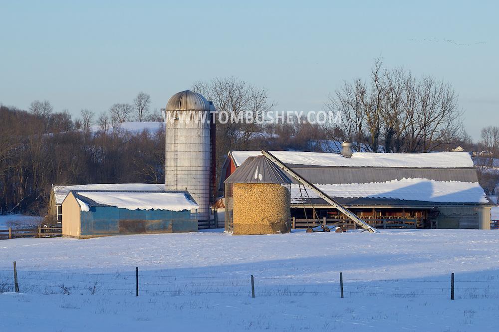 Goshen, New York - Snow-covered fields and farm buildings n Feb. 10, 2013.Winter farm scene