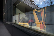 Musical instruments in the window of the education centre for children and families at the Philarmonie de Paris, or Philharmonie 1, in the Cite de la Musique in the Parc de la Villette in the 19th arrondissement of Paris, France. The building houses a symphony hall by Jean Nouvel, opened in 2015, home of the Orchestre de Paris, and concert halls, exhibition spaces, rehearsal rooms, educational services, restaurant and bars. Picture by Manuel Cohen
