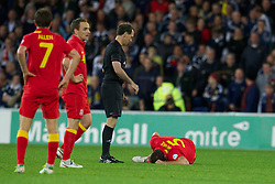 CARDIFF, WALES - Friday, October 12, 2012: Wales' Darcy Blake injured during the Brazil 2014 FIFA World Cup Qualifying Group A match against Scotland at the Cardiff City Stadium. (Pic by David Rawcliffe/Propaganda)