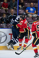 PENTICTON, CANADA - SEPTEMBER 16: Rasmus Anderson #54 of Calgary Flames checks Axel Blomqvist #65 of Winnipeg Jets on September 16, 2016 at the South Okanagan Event Centre in Penticton, British Columbia, Canada.  (Photo by Marissa Baecker/Shoot the Breeze)  *** Local Caption *** Rasmus Anderson; Axel Blomqvist;