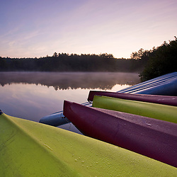 Kayaks next to Otter Lake at dawn in Greenfield State Park in Greenfield, New Hampshire.