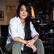28 year old Malaysian Documentary Photographer, Suzanne Lee poses for a portrait in her home-office in New Delhi, India. Photo: Sanjit Das/Panos