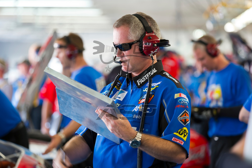CONCORD, NC - MAY 26, 2012:  Crew Chief, Bob Osborne, takes notes during a practice session for the Coca-Cola 600 at the Charlotte Motor Speedway in Concord, NC.