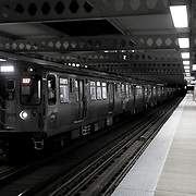 Chicago El Blue Line Trains at Night / Western Avenue Blue Line Station