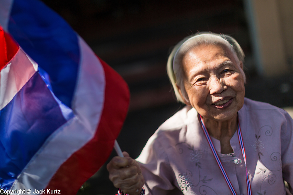 "15 JANUARY 2014 - BANGKOK, THAILAND: An elderly woman waits for anti-government protest leader Suthep Thaugsuban in Bangkok. Tens of thousands of Thai anti-government protestors continued to block the streets of Bangkok Wednesday to shut down the Thai capitol. The protest, ""Shutdown Bangkok,"" is expected to last at least a week. Shutdown Bangkok is organized by People's Democratic Reform Committee (PRDC). It's a continuation of protests that started in early November. There have been shootings almost every night at different protests sites around Bangkok. The malls in Bangkok are still open but many other businesses are closed and mass transit is swamped with both protestors and people who had to use mass transit because the roads were blocked.    PHOTO BY JACK KURTZ"