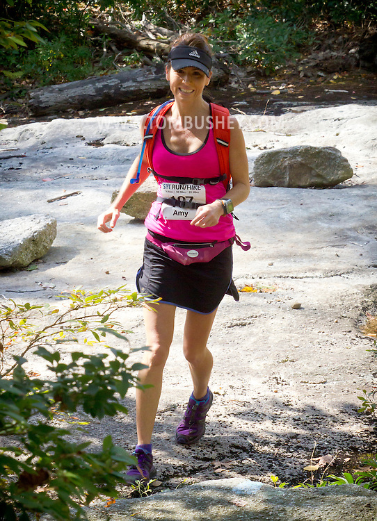 Kernhonkson, New York - Amy Hanlon runs along the trail at Minnewaska State Park Preserve during the Shawangunk Ridge Trail Run/Hike 32-mile race  on Sept. 20, 2014.
