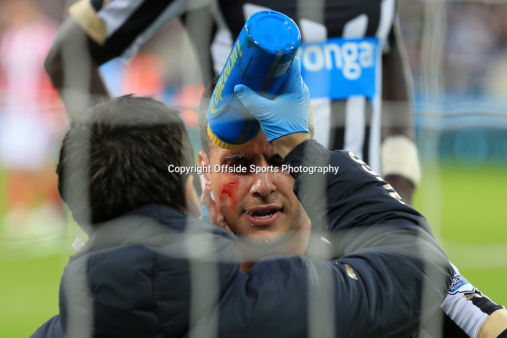 21st December 2014 - Barclays Premier League - Newcastle United v Sunderland - Steven Taylor of Newcastle sustains a bloody cut to his face - Photo: Simon Stacpoole / Offside.