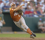 Texas third basemen fires the ball to first base to end the seventh inning against Baylor.  Texas defeated Baylor in the first round of the College World Series 5-1 at Rosenblatt Stadium in Omaha, Nebraska on June 18, 2005.