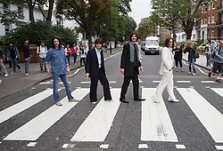 Image ©Licensed to i-Images Picture Agency. 08/08/2014. London, United Kingdom. The Beatles Abbey road 45th anniversary mass crossing. Members of 'Let it Be' musical cross Abbey Road for the 45th anniversary. Picture by Daniel Leal-Olivas / i-Images