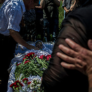 The funeral of Elena Ott, a 42 year old woman shot dead by the army near Starovarvarovka.