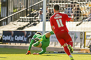 Another save from Notts County goalkeeper Roy Carroll as York City midfielder Josh Carson looks on during the Sky Bet League 2 match between Notts County and York City at Meadow Lane, Nottingham, England on 26 September 2015. Photo by Simon Davies.