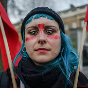 London, UK. 8th March, 2017. A feminist activist from Fourth Wave protests outside Downing Street on International Women's Day to draw attention to the disproportionate impact on women of the Government's continuing programme of austerity cuts. by See Li