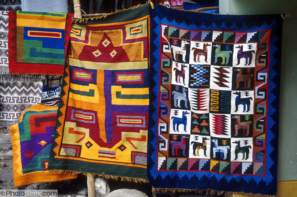 "Woven rugs for sale, Aguas Calientes village (""Machupicchu Town"") at the foot of Machu Picchu, in Peru, South America."