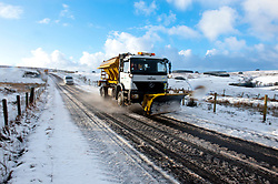 © Licensed to London News Pictures. 17/01/2015. A gritting truck works on the B4520 'Brecon Road' between Brecon and Builth Wells. There was overnight snowfall on high land in Mid Wales. Mynydd Epynt, Powys , Wales, UK. Photo credit: Graham M. Lawrence/LNP