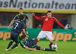 VIENNA, AUSTRIA - Thursday, October 6, 2016: Wales' Andy King and Joe Allen tackle Austria's Zlatko Junuzovic during the 2018 FIFA World Cup Qualifying Group D match at the Ernst-Happel-Stadion. (Pic by David Rawcliffe/Propaganda)