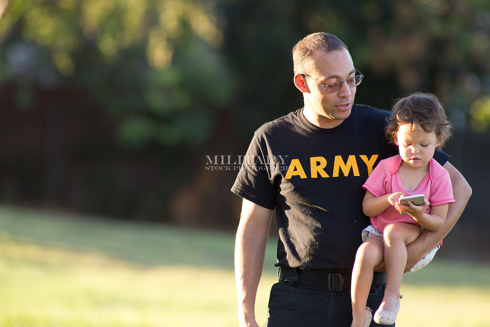 Male soldier, model released, DoD-compliant, off-duty, black PT shirt, sunset light.  Stock photograph by Hans Halberstadt.  Reproduction requires written permission from Hans Halberstadt, Military Stock Photography, or designated representative