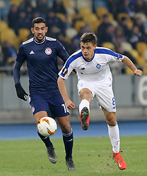 February 21, 2019 - Kiev, Ukraine - Dynamo Kyiv's Volodymyr Shepeliev (R) fights for the ball with Olympiacos Ahmed Hassan (L) during the UEFA Europa League round of 32 second leg football match between Olympiacos FC and FC Dynamo Kyiv at the Olimpiyskiy Stadium in Kiev on February 21, 2019. (Credit Image: © Str/NurPhoto via ZUMA Press)
