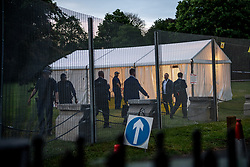 © Licensed to London News Pictures. 04/06/2019. London, UK. Secret Service liaison officers move to a checkpoint as guests prepare to leave Winfield House, the US ambassador's residence in Regent's Park,  after a dinner hosted by US President Donald Trump and First Lady Melania Trump bringing a  conclusion to day 2 of the state visit to the UK.   Photo credit: Guilhem Baker/LNP
